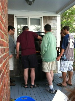 family around a barbecue grill